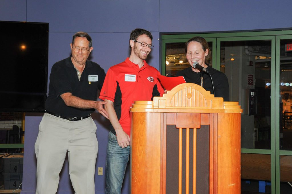A mentor pushes me up to the podium to accept recognition, from the President & CEO of the Cincinnati Museum Center, for my contributions to the Kenner And The Building Of An Empire exhibit.